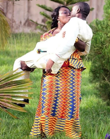 Photo Of Bride Carrying Her Husband As They Kiss Passionately Goes Viral